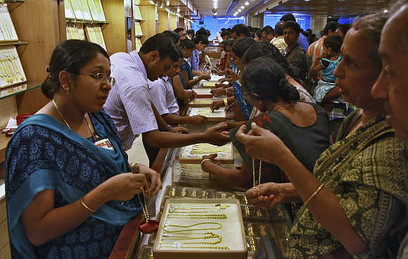 Customers at a gold jewellery showroom in Kochi.