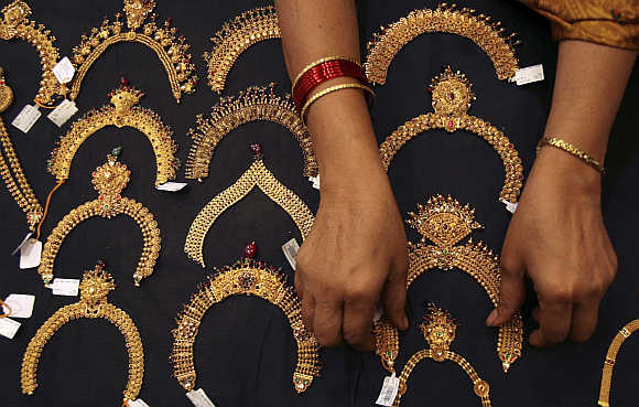 A woman checks a gold necklace inside a jewellery showroom in Hyderabad.