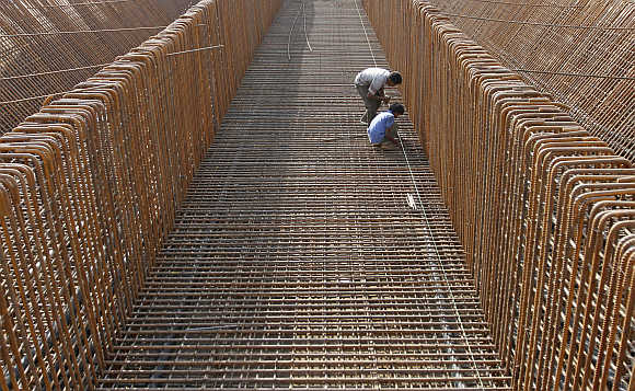 Labourers at a construction site of a flyover in Ahmedabad.