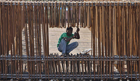 A labourer works at a construction site of a flyover in Ahmedabad.