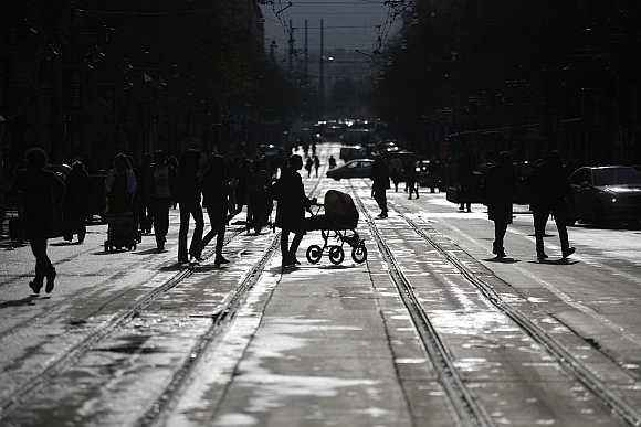 People walk on a street in downtown Sofia, Bulgaria.
