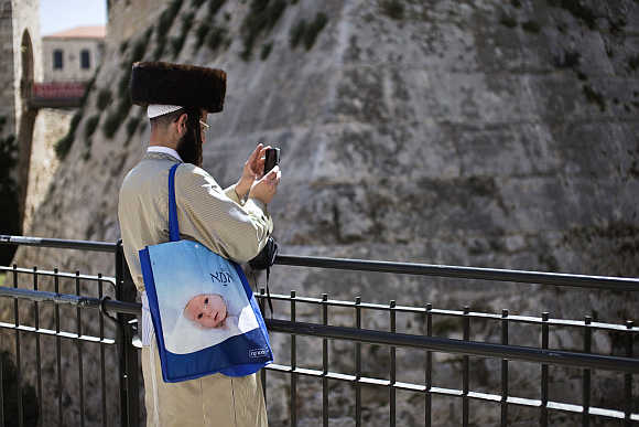 An ultra-Orthodox Jewish man uses his mobile phone to take a picture in Jerusalem's Old City.