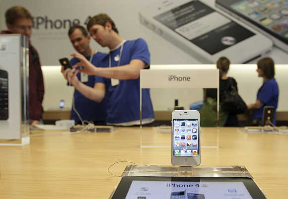 An iPhone 4S is shown at Apple's flagship retail store in San Francisco, California.