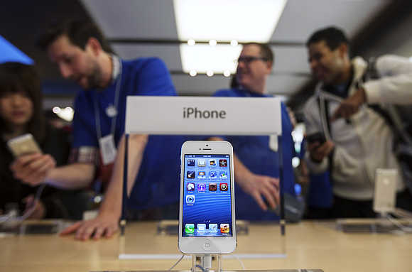 An iPhone 5 is displayed in the Apple Store on Fifth Avenue in New York.
