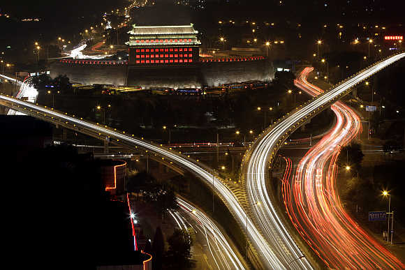 Deshengmen Embrasure Watchtower is lit by coloured lights in Beijing, China.