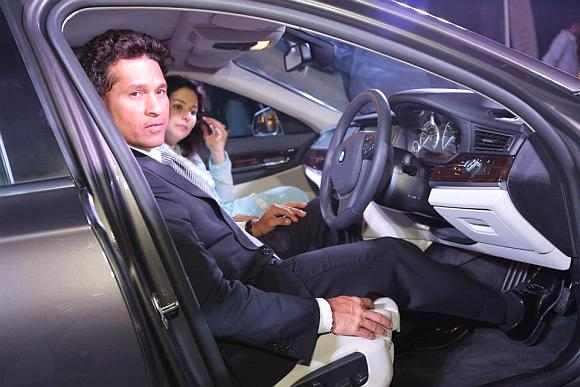 Sachin Tendulkar and his wife Anjali Tendulkar in the new BMW 7 Series.