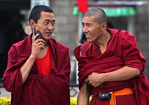 ibetan monks use their mobile phones in Lhasa, Tibet.