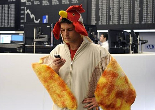 A stock trader dressed as a chicken stands on the trading floor at the German stock exchange in Frankfurt.