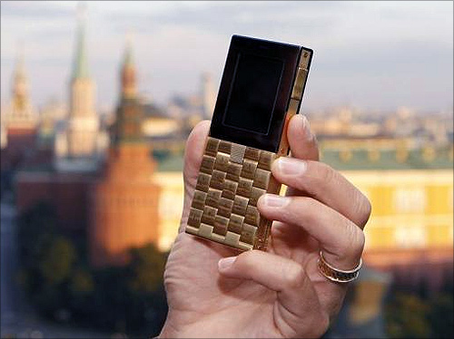 Mathias Rajani, Danish luxury product company Aesir's chief commercial officer, holds a model of his company's new mobile phone during a press presentation in Moscow.