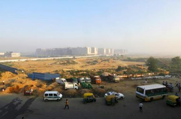 Traffic moves past hotels being constructed outside the Indira Gandhi International Airport in New Delhi.