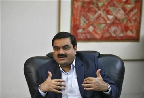 Billionaire Gautam Adani speaks during an interview.