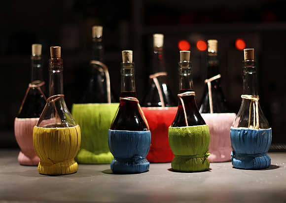 Traditional fiascos (bottles) of chianti wine are seen at the L'e'Maiala restaurant in Florence, Italy.