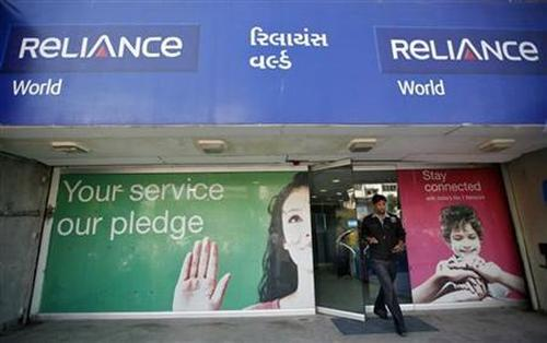 A customer leaves a Reliance communication store in Ahmedabad.