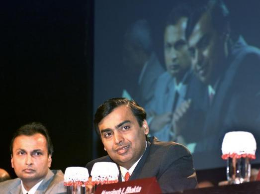 Mukesh Ambani and Anil Ambani are seen in Mumbai.