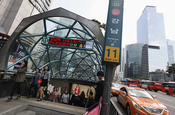 People come out at subway station in the Gangnam area of Seoul in South Korea.