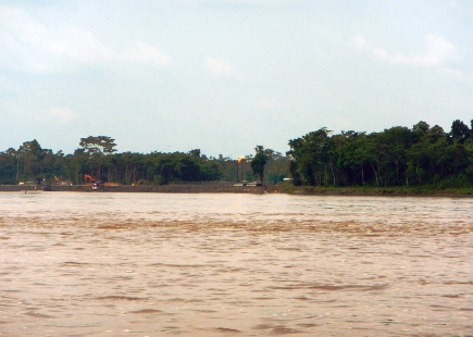 Oil well flares along the Napo river spell trouble.