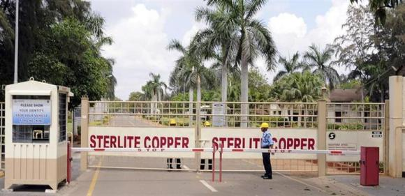 A private security guard stands in front of the main gate of Sterlite Industries Ltd's copper plant in Tuticorin in Tamil Nadu.