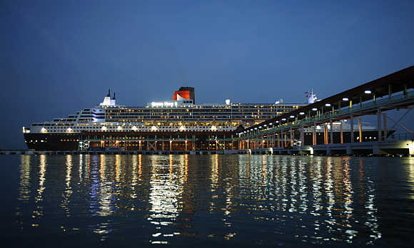 World's largest ocean liner Queen Mary 2 docks at a jetty in Port Klang, outside Kuala Lumpur, Malaysia.