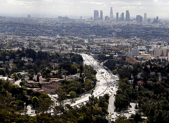 Skyline of downtown Los Angeles and the 101 Hollywood Freeway, a busy commuter route, is pictured from Mulholland Drive.