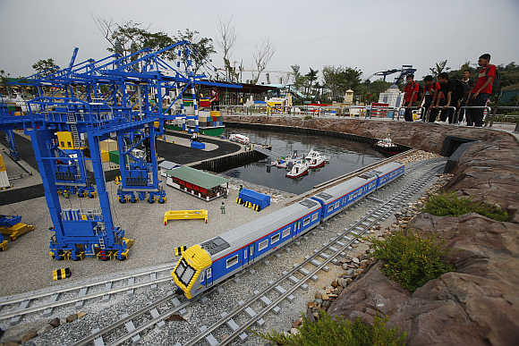 A lego train passes through a model of Malaysia's Tanjung Pelepas shipyard in the southern state of Johor.