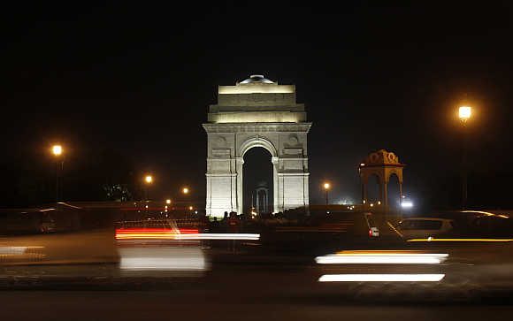 Traffic moves in front of the India Gate in New Delhi.