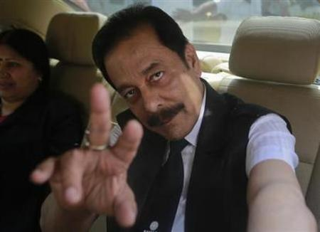 Sahara Group Chairman Subrata Roy gestures as he arrives at the Securities and Exchange Board of India (SEBI) headquarters in Mumbai April 10, 2013.