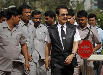 Sahara Group Chairman Subrata Roy accompanied by his security leaves the Securities and Exchange Board of India headquarters in Mumbai.