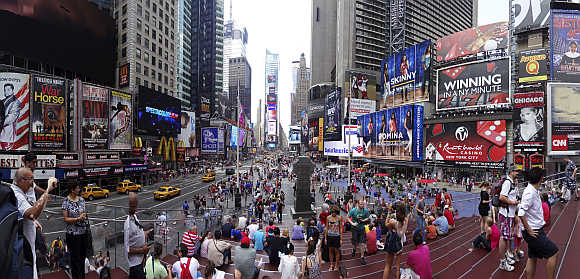 Tourits gather in Times Square in New York City.
