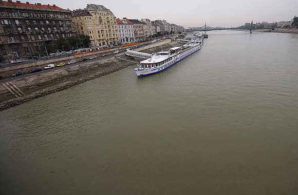 Cruise ships are floating on the Danube river in central Budapest in Hungary.