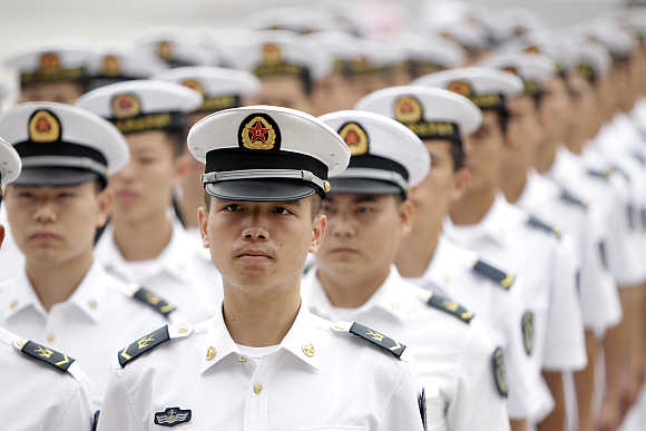 People's Liberation Army navy sailors stand at the Great Hall of the People in Beijing.
