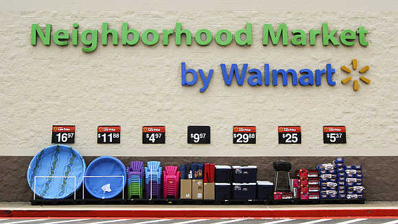 Products are displayed outside a Wal-Mart Neighborhood Market store in Bentonville, Arkansas.