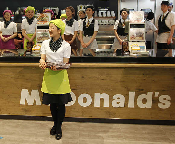 McDonald's counter staff wait for the opening of its Harajuku-Omotesando shop in Tokyo, Japan.