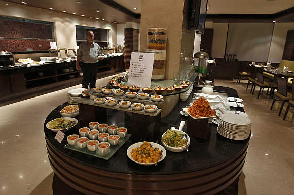 A guest walks inside a restaurant of the Four Points hotel in Ahmedabad.