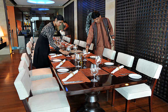 Employees of Taj Mahal hotel prepare 'Souk' restaurant in Mumbai.