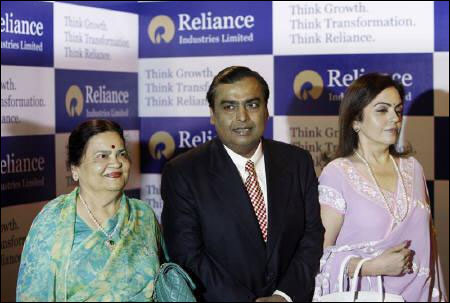 Mukesh Ambani, chairman of Reliance Industries with his wife Nita Ambani (R) and mother Kokilaben Ambani (L).