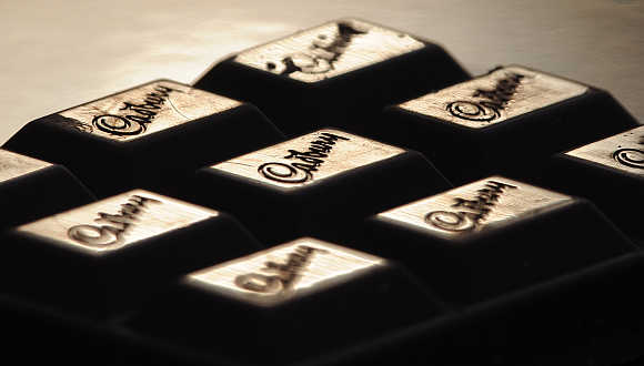 Cadburys logo on a bar of chocolate.