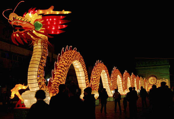 A hundred-meter-long (328 feet) lantern, featuring a dragon and made of 10,000 used compact discs and auto parts, is lit up in Hami, Xinjiang Uygur Autonomous Region.
