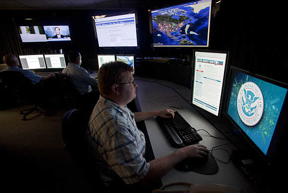 Analysts work in a watch and warning center of a cyber security defense lab at the Idaho National Laboratory in Idaho Falls, Idaho, United States.