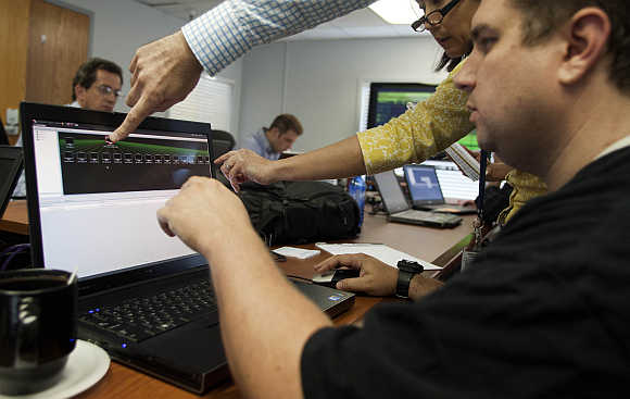 Attacking team members work to hack into a network during a drill at a Department of Homeland Security cyber security defense lab at the Idaho National Laboratory in Idaho Falls, Idaho, United States.