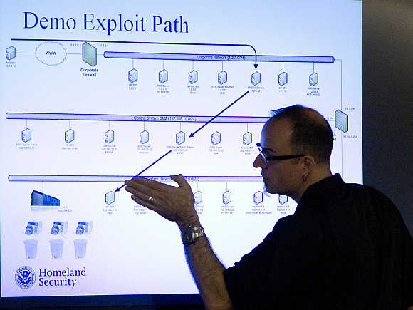 Mark Fabro, a training consultant working with the U.S. Department of Homeland Security, explains how systems can be exploited at a cyber security defense lab at the Idaho National Laboratory in Idaho Falls, Idaho, United States.