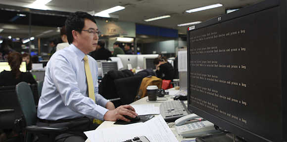 A computer is seen down after hacking at main office of broadcaster YTN in Seoul, South Korea.