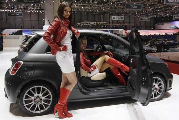 Models present the Abarth 695 Black Diamond on the company's booth during the first media day of the Geneva Auto Show.