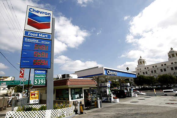 Gas prices are displayed at a Chevron gas station in Los Angeles, California.