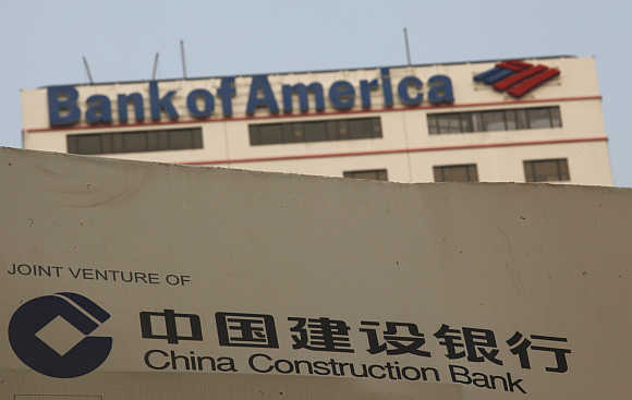 A construction site of the Hong Kong headquarters of China Construction Bank (Asia) is seen in front of Bank of America Tower at Hong Kong's financial Central d