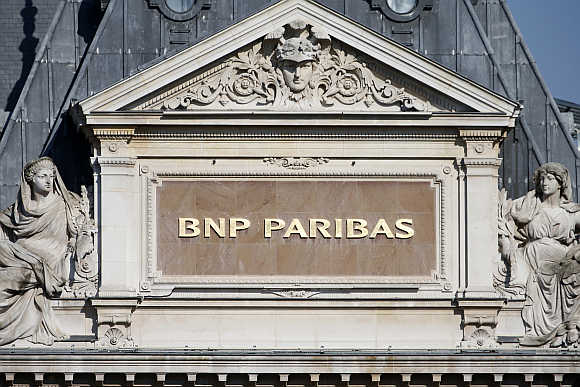 BNP Paribas plaque is seen on the roof of one of their main banks in central Paris.