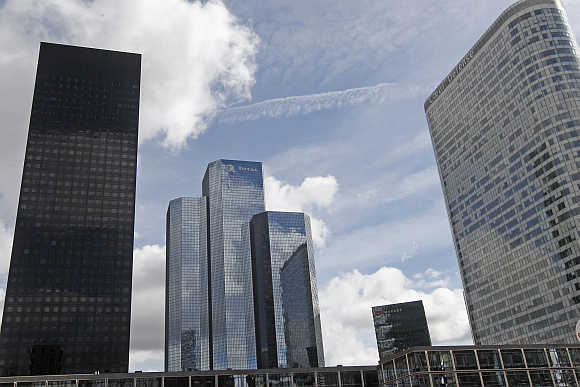 A view of Total building named Total Coupole Tower, centre, at the La Defense business district in Courbevoie near Paris.