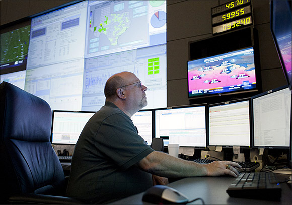 An executive monitors power use on the big screen.