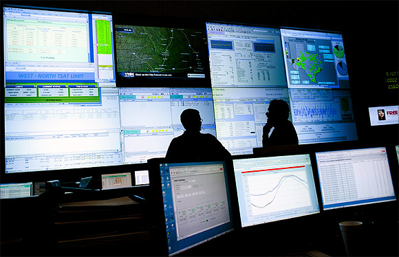 Engineers monitor a state power grid in the US.