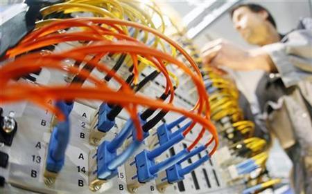 A worker prepares a server.