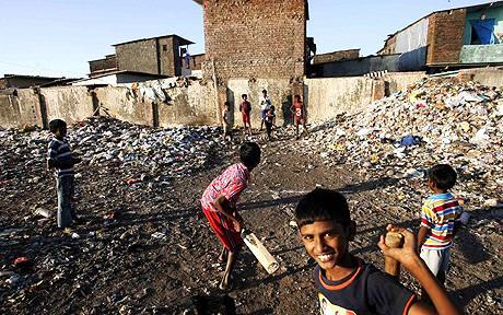 Slum children play cricket in Mumbai.